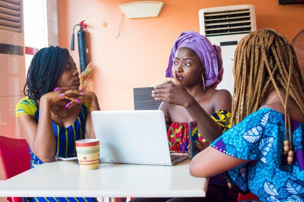 groupofyoungafricanwomendiscussingsomethingimportant-threeafrican